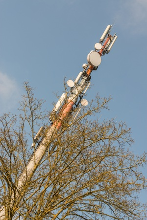 Mobile cell tower in front of blue sky, Germany