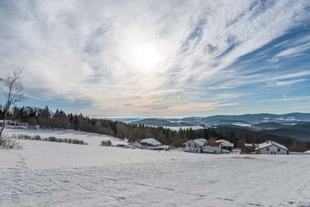 Snow covered landscape of Bavarian forest with view to the Alps, Bavaria, Germany Stock Photo