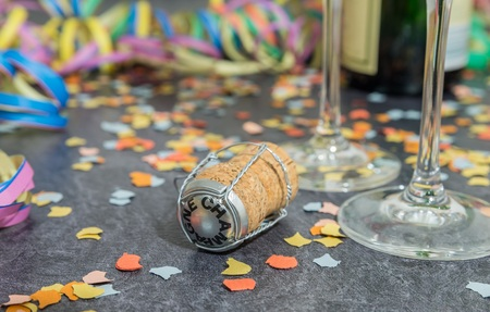 Champagne cork with carnival decoration on a slate
