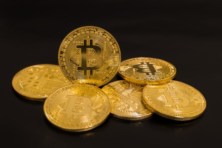 Gold coins bitcoin isolated on black background