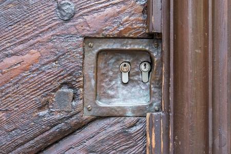 Old wooden door with two locks 写真素材