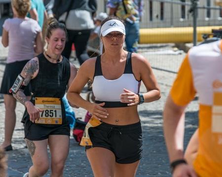 Regensburg, Bavaria, Germany, May 13, 2018: Participant of the Regensburg Marathon 2018 at the old city hall 報道画像