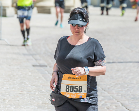 Regensburg, Bavaria, Germany, May 13, 2018: Participant of the Regensburg Marathon 2018 at the old city hall Editorial