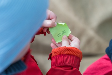 Little boy drew a blank by lot - English words: New ticket - new luck!