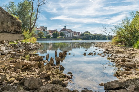 Low water level of the Danube with a view of the Iron Bridge in Regensburg, Germany Stock Photo