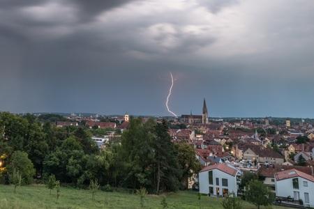 Dark clouds with lightning above lightning above Regensburg, Germany