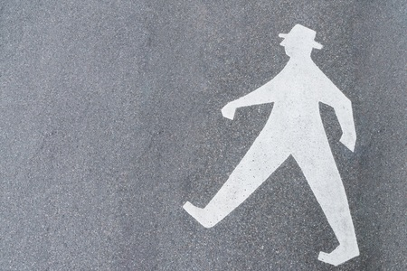 Old male pedestrian symbol on a street in Germany