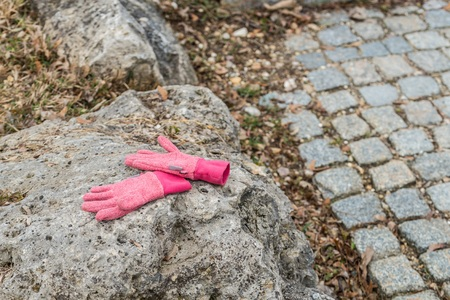 Left lying child on a stone in a park
