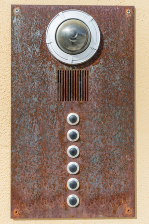Old rusty house bell with camera and intercom, Germany