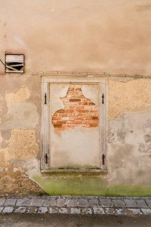 Window bricked up with bricks, Germany