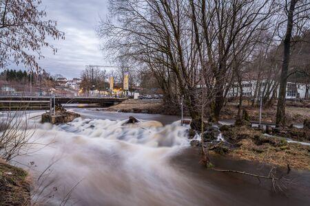 Grafenau, Bavaria, Germany, March 16, 2019, The river Gro?e Ohe in Grafenau at high water in spring, Germany Redakční