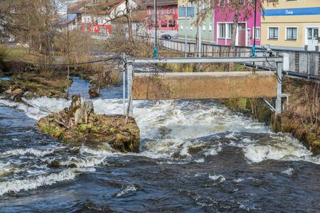 Grafenau, Bavaria, Germany, March 17, 2019, The river Grosse Ohe in Grafenau at high water in spring, Germany