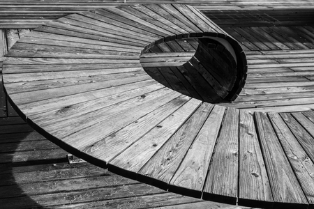 Black white image of modern geometric wooden construction intended as seating, Germany