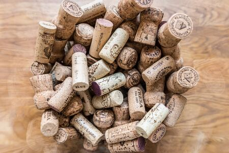 Regensburg, Bavaria, Germany, April 27, 2019, Many wine corks of different wines in a large glass of champagne cooler