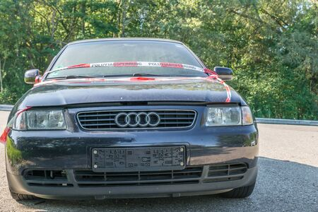 Hechingen, Baden-Württemberg, Germany, September 15, 2019, Close up of an Audi A3 after an accident with police barrier tape with German word for police barricade, Germany