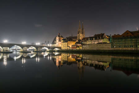 Shortly before the New Year's Eve fireworks in Regensburg with view of the cathedral and the stone bridge, New Year's Eve 2019-2020, Germany