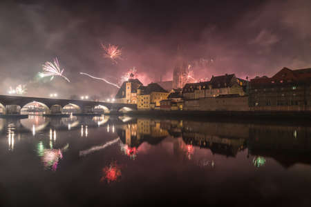 New Year's Eve fireworks in Regensburg with view of the cathedral and the stone bridge, Silvester 2019-2020, Germany
