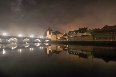 Shortly after the New Year's Eve fireworks in Regensburg with view of the cathedral and the stone bridge, New Year's Eve 2019-2020, Germany