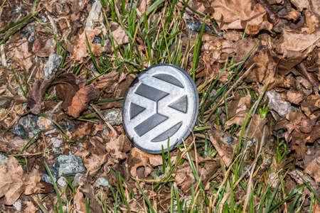 Grafenau, Bayern, Germany, March 15, 2020, VW logo on the ground at the roadside