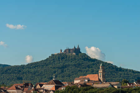 Picture taken on a sunny day from the city of Hechingen in the foreground and Hohenzollern Castle in the background, Germany