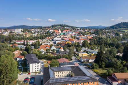 Picture of an aerial view with a drone of the town Grafenau in the Bavarian forest with mountains Arber Rachel and Lusen in the background, Germany 免版税图像 - 157620594