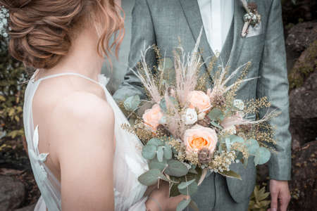 Bride and groom with a bridal bouquet before a wedding, Germany Standard-Bild