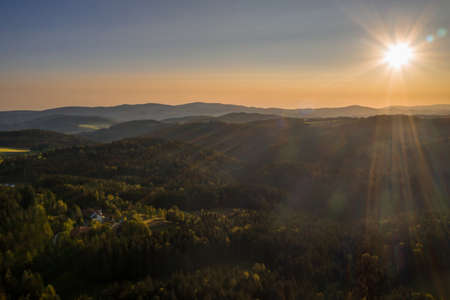 Picture of an aerial view in the Bavarian forest with landscape and mountains in the background during sunset, Germany 免版税图像 - 158666972