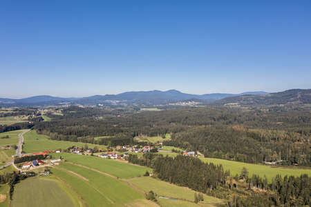 Picture of an aerial view with a drone of the landscape in the Bavarian forest near Grafenau with the mountain of little and big Rachel, Germany 免版税图像 - 158693617