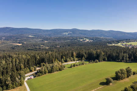 Picture of an aerial view with a drone of the landscape in the Bavarian forest near Grafenau with the mountain of little and big Rachel, Germany 免版税图像