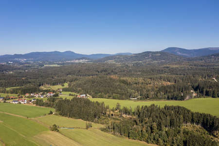 Picture of an aerial view with a drone of the landscape in the Bavarian forest near Grafenau with the mountain of little and big Rachel, Germany 免版税图像 - 158693622