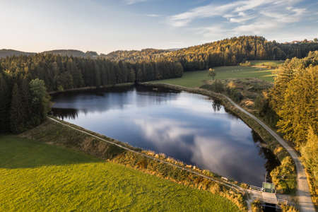 Picture of an aerial view of the landscape in the Bavarian forest and the reservoir at Großarmschlag near Grafenau, Germany