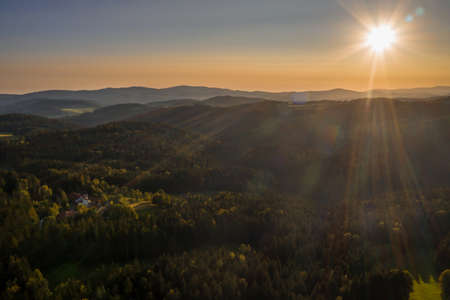 Picture of an aerial view in the Bavarian forest with landscape and mountains in the background during sunset, Germany 免版税图像