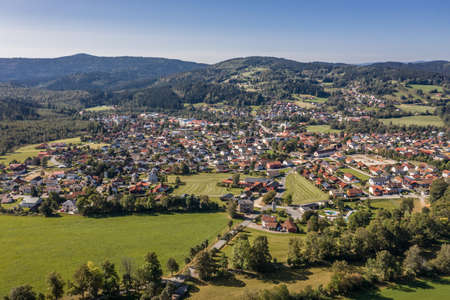 Picture of an aerial view of the community Frauenau in the Bavarian forest with landscape and mountains in the background, Germany