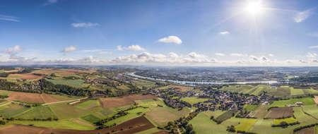 Picture of a panorama aerial view of the city of Regensburg in Bavaria and the landscape with the river Danube and fields and meadows, Germany