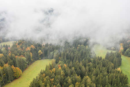 Image of an aerial view of low-hanging clouds above the trees of a forest in the Bavarian Forest, Germany 免版税图像 - 159386969