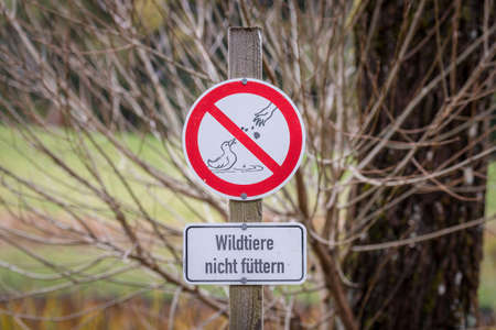 A prohibition sign in German language with the text - Do not feed wild animals, Germany