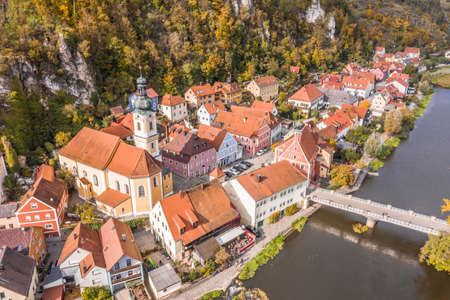 Image of an aerial view with a drone of the city view of the market Kallmünz Kallmuenz in Bavaria and the bridge over the rivers Naab and Vils and the castle ruin on the mountain, Germany