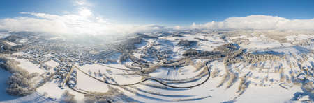 Panorama picture of town Grafenau and village Grueb in Bavarian forest with mountains landscape in winter with snow and ice, Germany 免版税图像