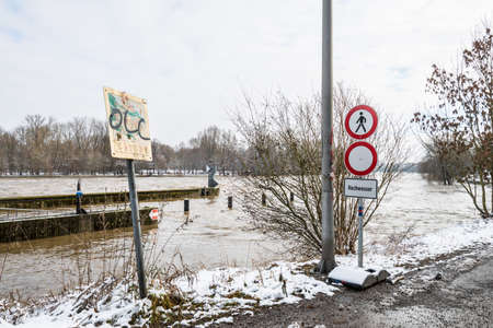 Prohibition signs at the flood of the river Danube in winter 2021 in Regensburg with the notice - flood - in German language