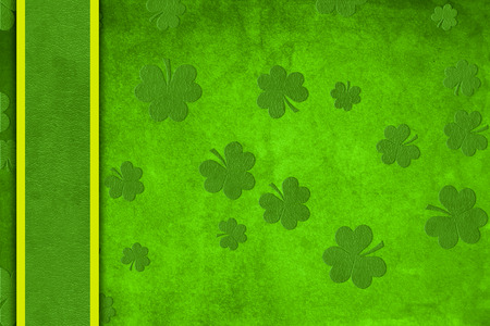 St. Patricks day greeting card with green grungy backdrop, clover and a border Stock Photo