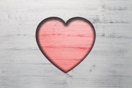 A romantic beautiful Valentines Day Background and greeting card. An coloured Illustration with wooden Background and a red wooden heart with copy space.