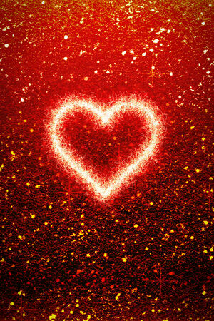 A romantic beautiful Valentines Day Background and greeting card. An coloured Illustration with red gliiter textured Background and a glowing heart with copy space.