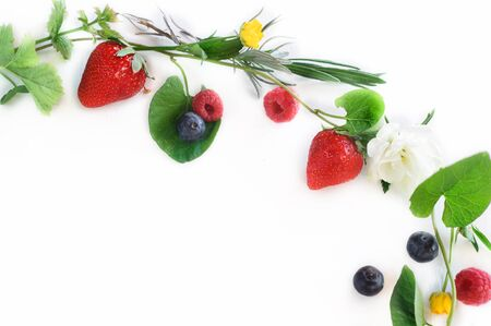 Spring fruits and flowers garland isolated on white