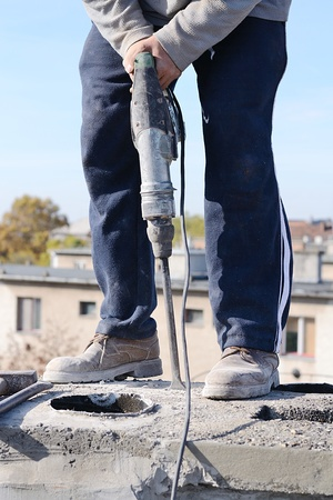 Worker use the breaker hammer on the chimney Stock Photo - 16221239