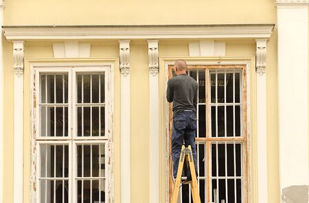 Man restores the window, detail