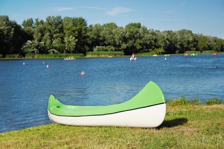 summer sport: Canoe on beach a sunny day, detail