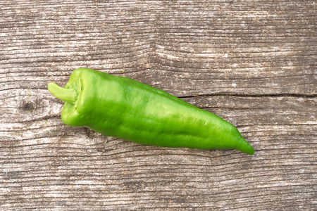 green pepper: Fresh green pepper on wooden background Stock Photo