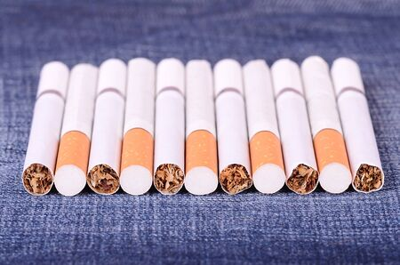 boodle: Closeup photo of cigarettes on a blue jeans background Stock Photo