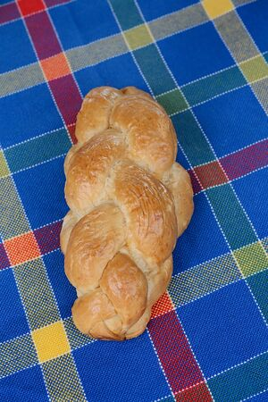 braided: Braided loaf on table Stock Photo