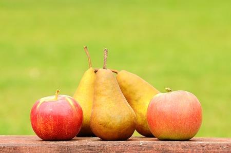 ingradient: Fresh pear and apple after harvest on wooden desk